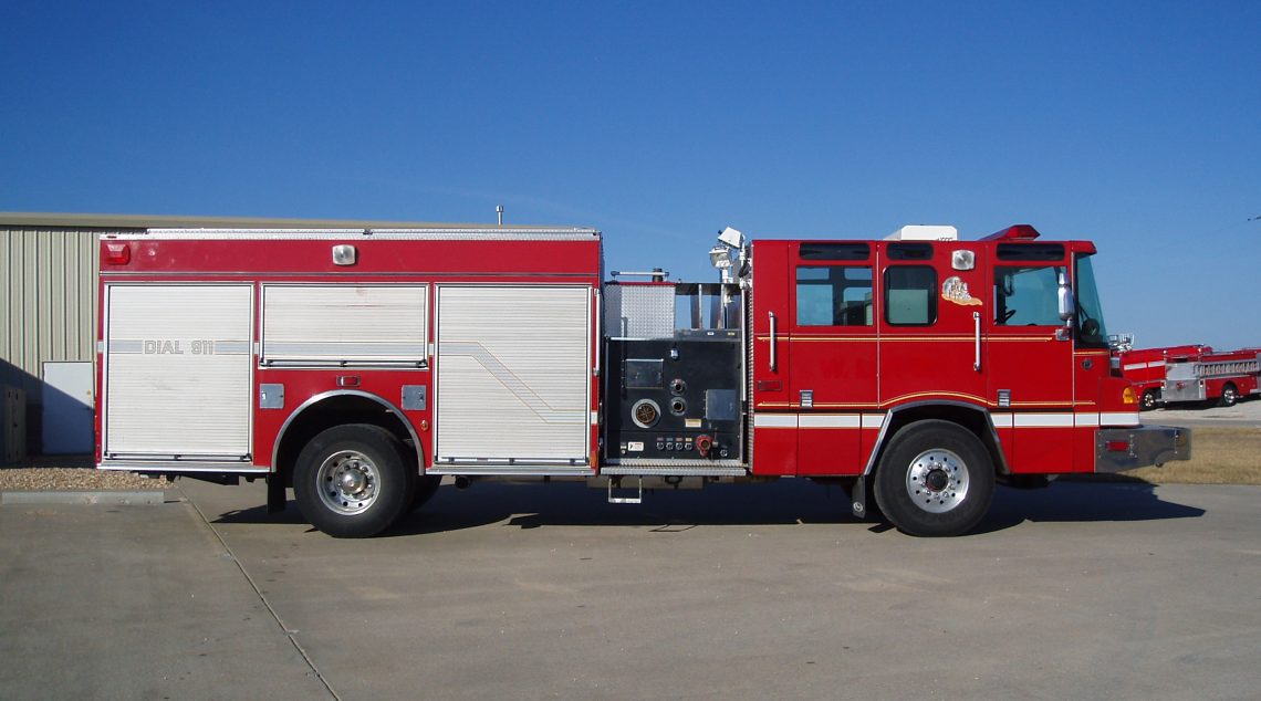 Quantum Rescue Pumper side view with control panel and hose mount