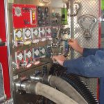 man testing fire apparatus pump