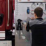 man repairing a fire truck
