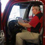 man sitting in fire truck Jon's Mid-America Fire Apparatus