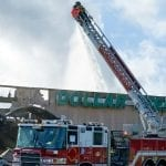 firefighter putting out fire at Dollar Tree Jon's Mid-America Fire Apparatus