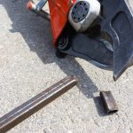 Hydraulic shears cutting a metal rod