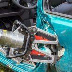 Hydraulic spreader hydraulic rescue tool working on a damaged car